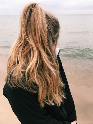 long wavy hair in high ponytail