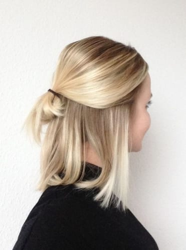 low half bun hairstyle