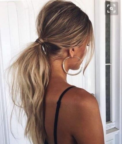 messy low ponytail