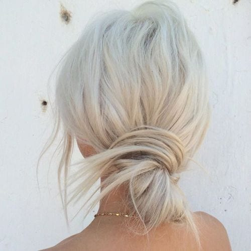 sleek messy platinum blonde bun