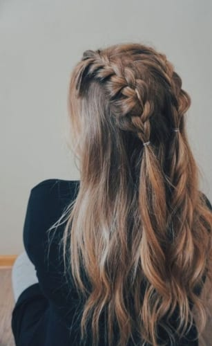 mid length plaits on long hair