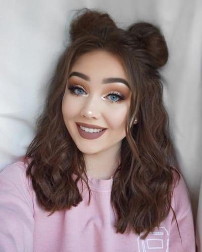 space buns on medium shoulder length hair