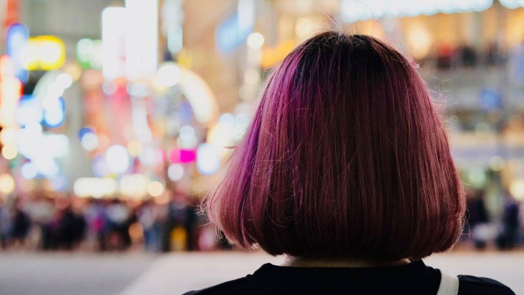 girl with short purple hair in the city