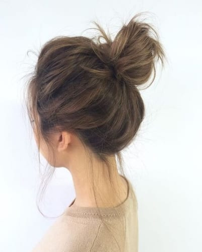 High and Messy and Voluminous Bun for Thick Hair