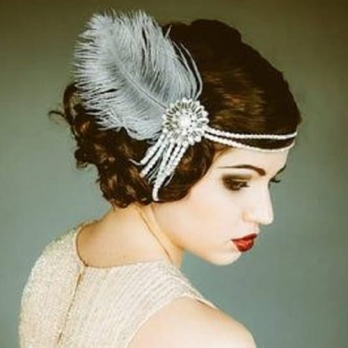 mid-length updo with feather detail